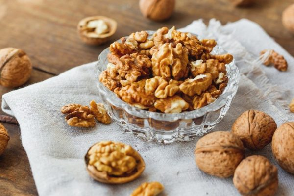 glass bowl with walnuts on rustic homespun napkin healthy snack picture id531534806 d 850